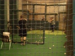 Edwin Maysonet taking some cuts in the cage with hitting coach Al LeBoeuf