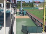 The Sounds' bullpen is in the background with the Isotopes' 'pen in the foreground