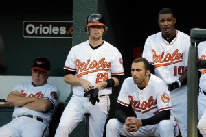 Blake Davis (28), shown in '11 with Orioles. O's manager & former Sound Buck Showalter shown at left.